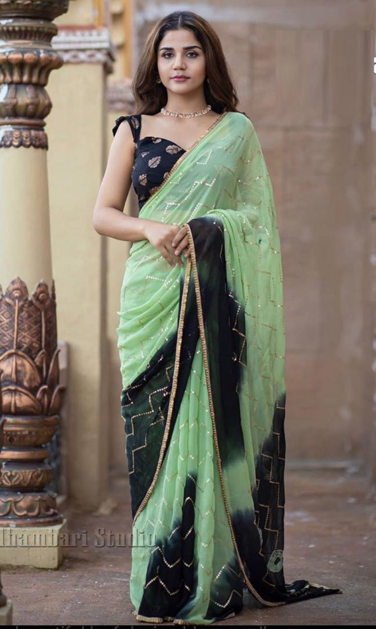 Capricious Pista And Black Color Embroidery Work Saree