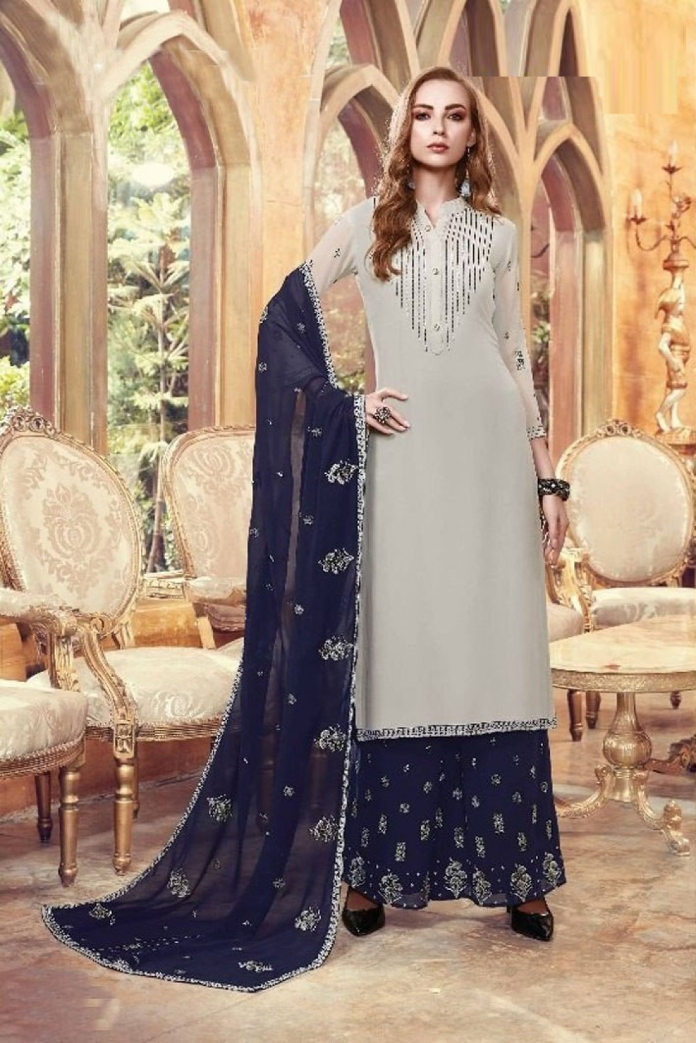 Eye catchingFaux Georgette Grey Colour Plazzo Suit