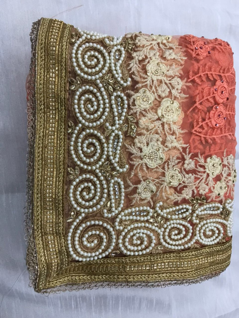 Majesty Peach Net With Embroidery Worked Saree