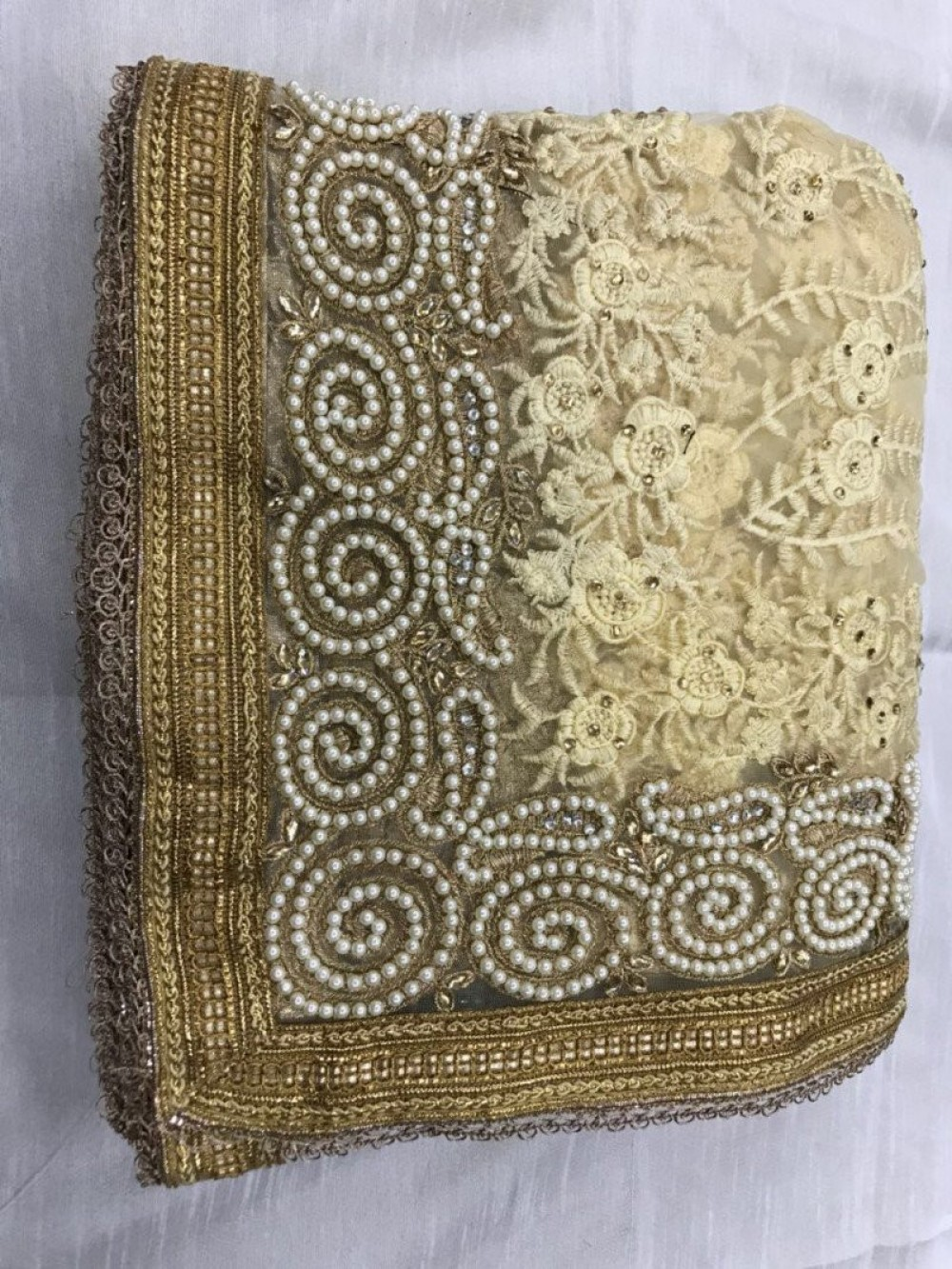 Appealing Net With Embroidery Worked Cream Colour Saree