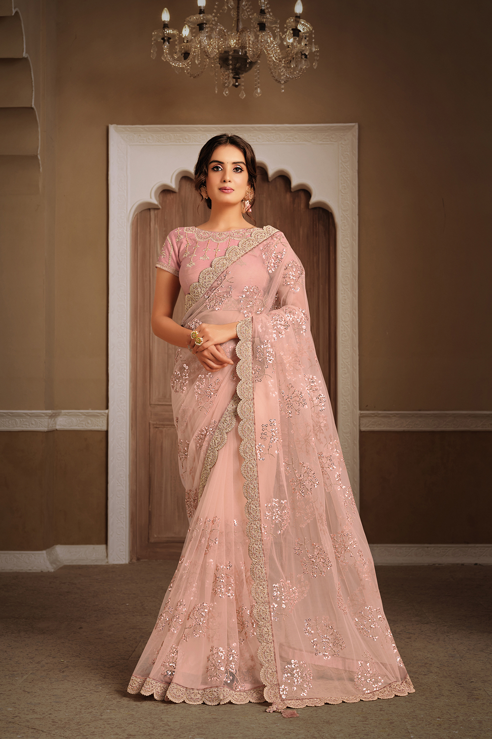 Soft pastel peach hue embedded sequins embroidery  saree
