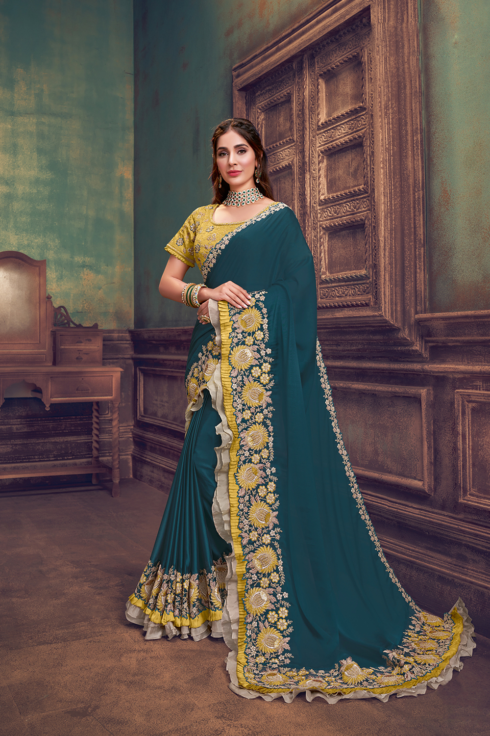 A sensational color combination of deep teal blue and mesmerizing shade of yellow   beige and gold will steal the heart ofthe wearer and the onlookers  With its maharani-like appeal   the saree is a heirloom piece anyone would want to save for the ge