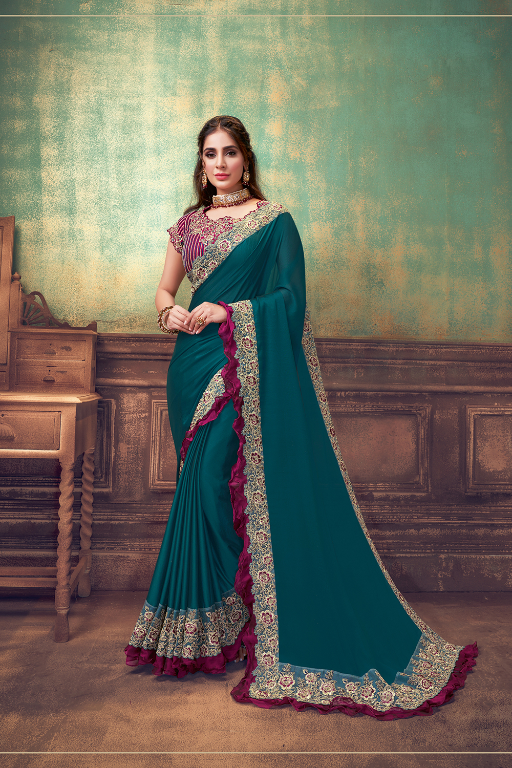 The future is simplicity and glamour combined with traditions  This deep jewel toned saree is with a contrasting wine resham and zari embroidery with prettiest frill additions this design is an apt pick for a women who wants her style to be unique wh