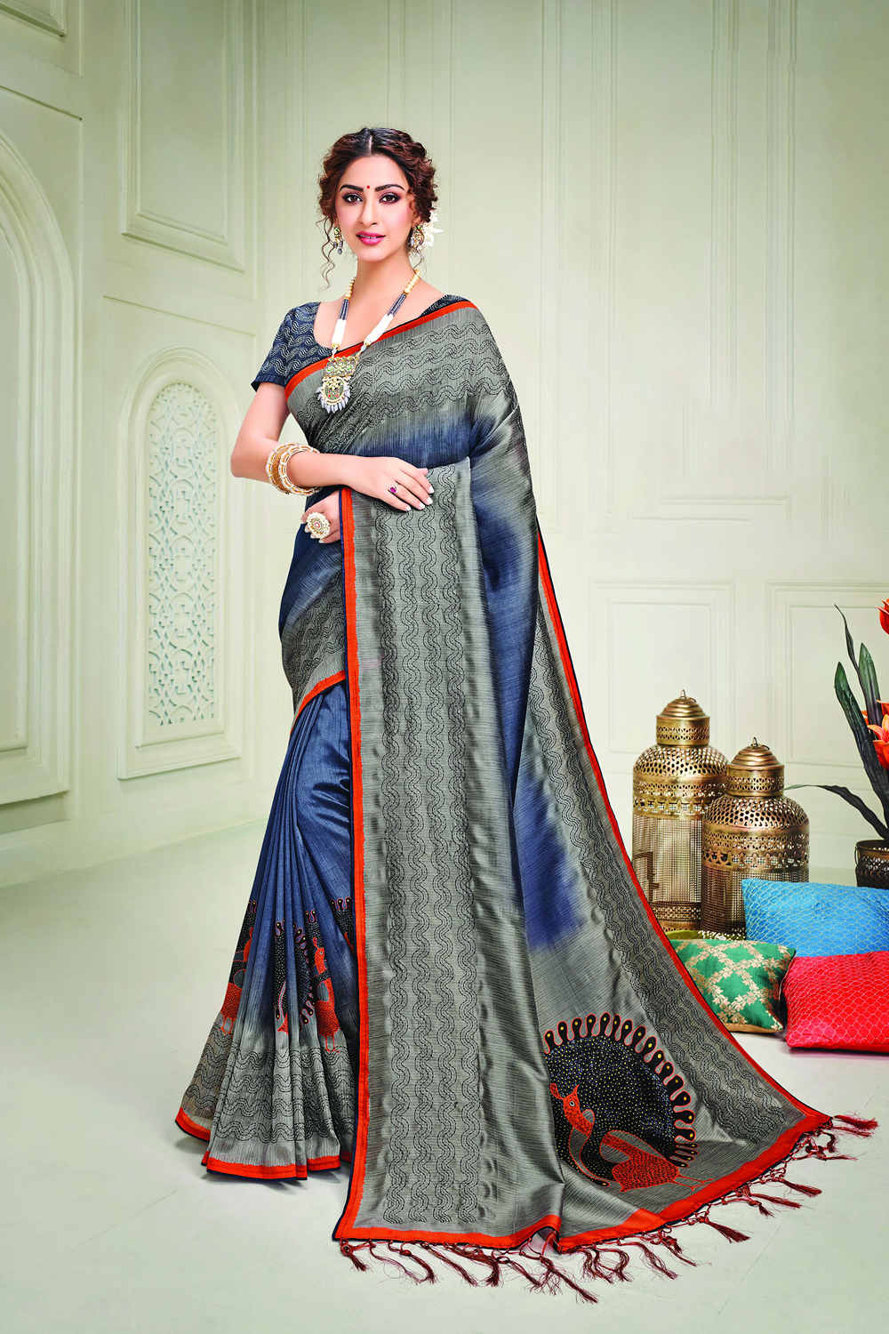 Grace your traditional occassions in this absolutely stunning kalamkari-inspired saree adorned with kantha embroidery details and look stunning   Pair with a statement temple-necklace to enhance the look