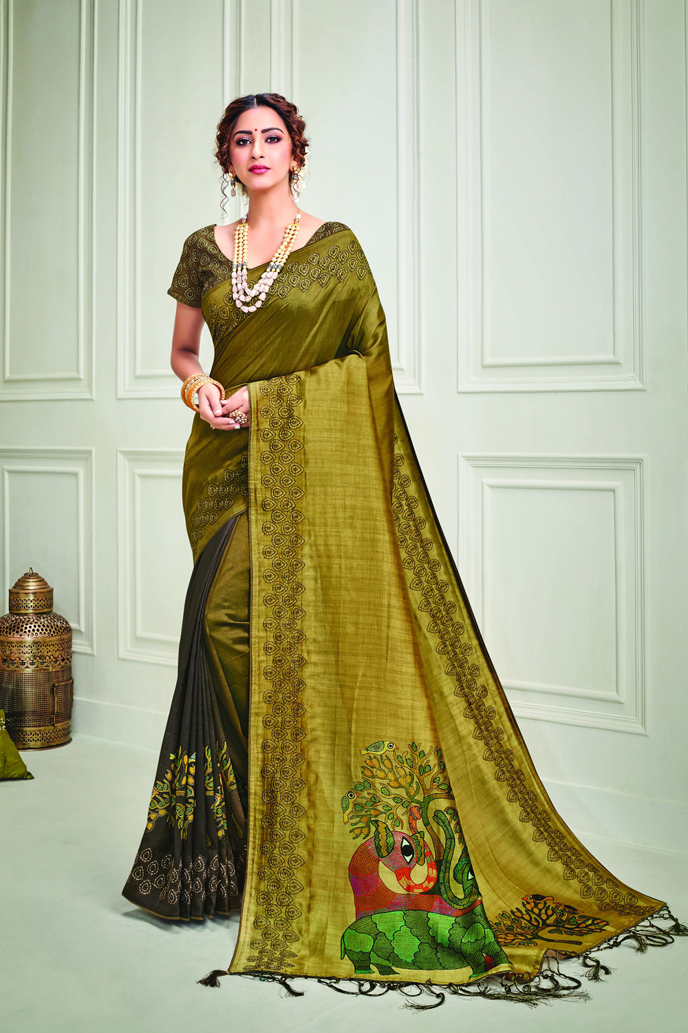 The color of elegance and warmth   this indian tonal saree is  uplifed in kalamkari-inspired print and kantha embroidered details is a perfect pick for any traditional occasions