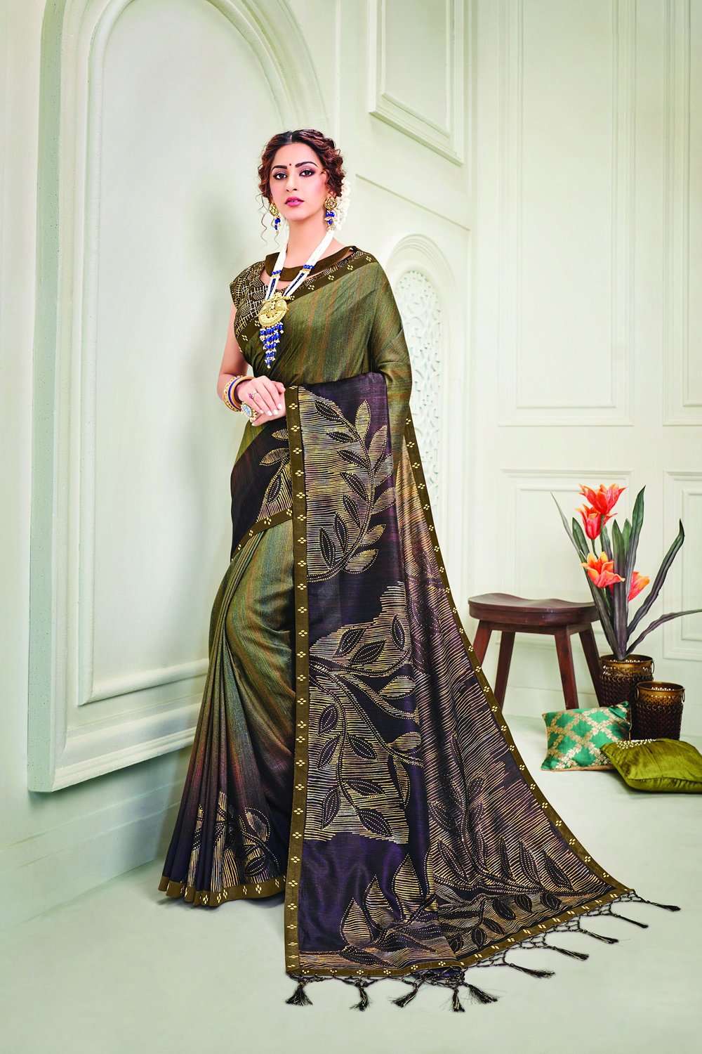Personify exquisiteness in this shaded two-tone saree perfected with metallic foil foil leaf motifs  Pair with a contrasting long maharani style necklace to give an added playful touch