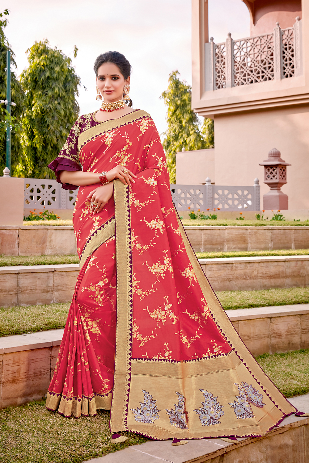 Delicate and ornate florals weaved meticulously in the auspicious Indian color- red saree