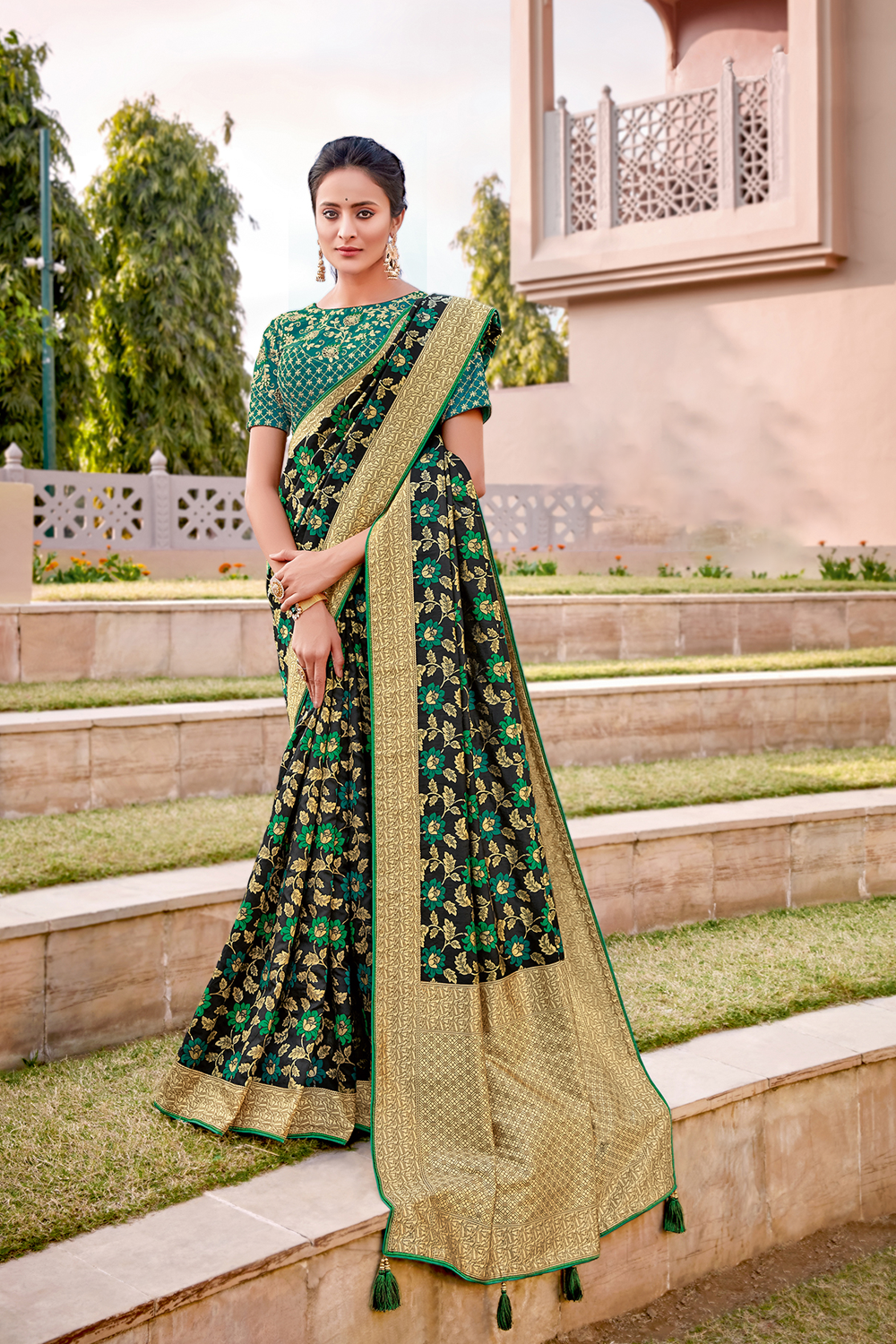 Adorned with the lotus motif  this earthy-green colored saree
