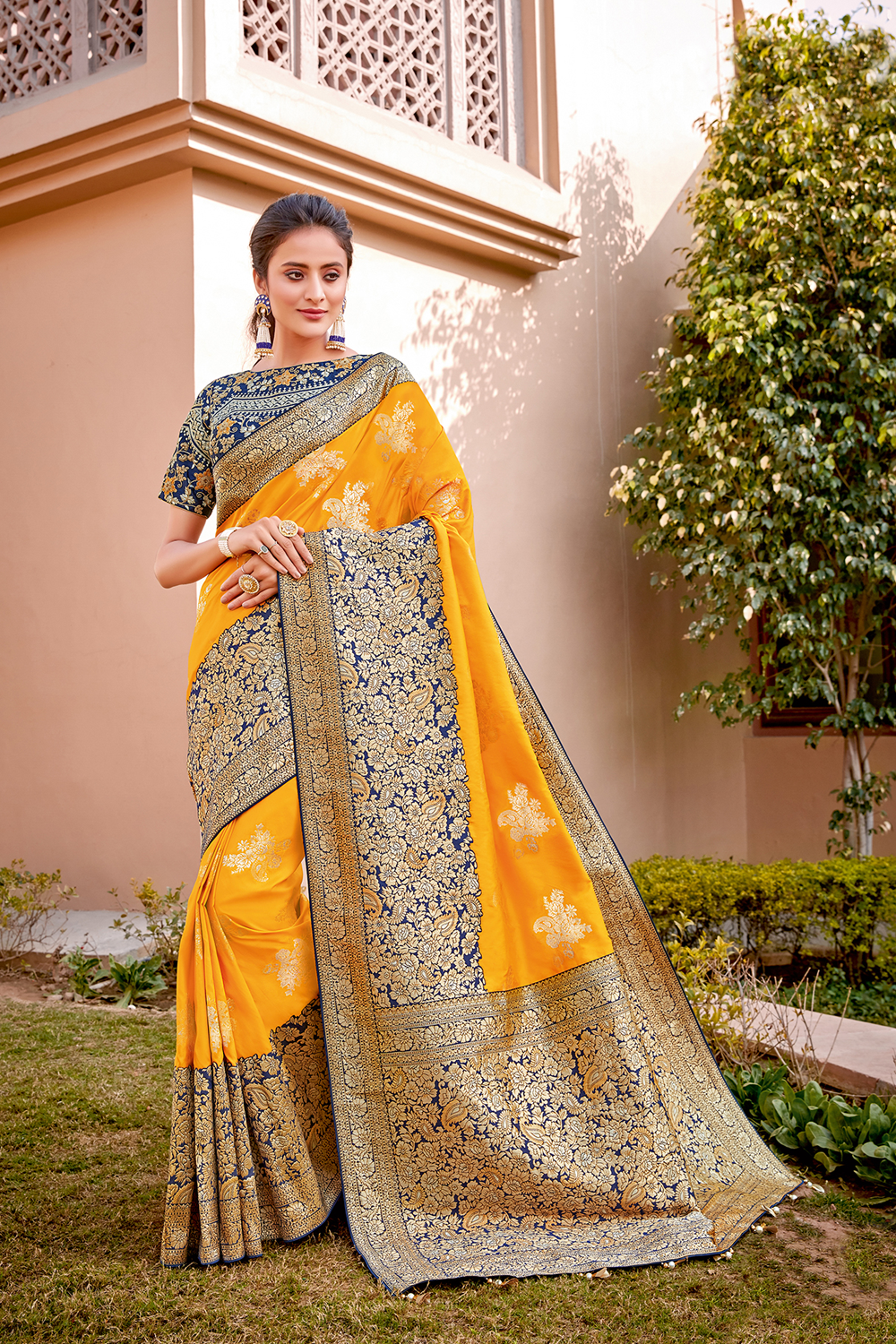 A tasteful combination of auspicious yellow and ornate floral weaves saree