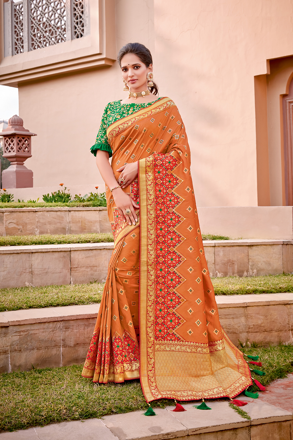 An excellent combination of Indian saffron and fresh green saree