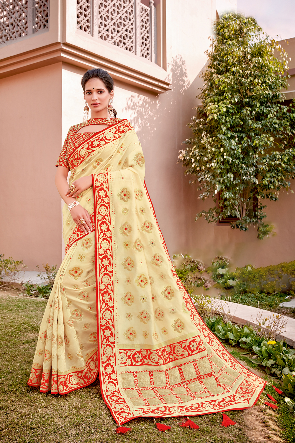 Red and cream combination   adorned in intricately floral weave and zari embroidery