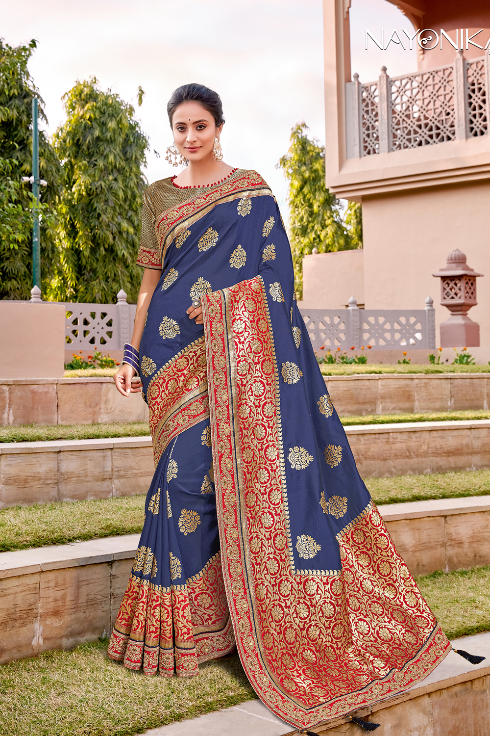 Blue saree paired with royal brocade and combined with a hint of delicate embroidery