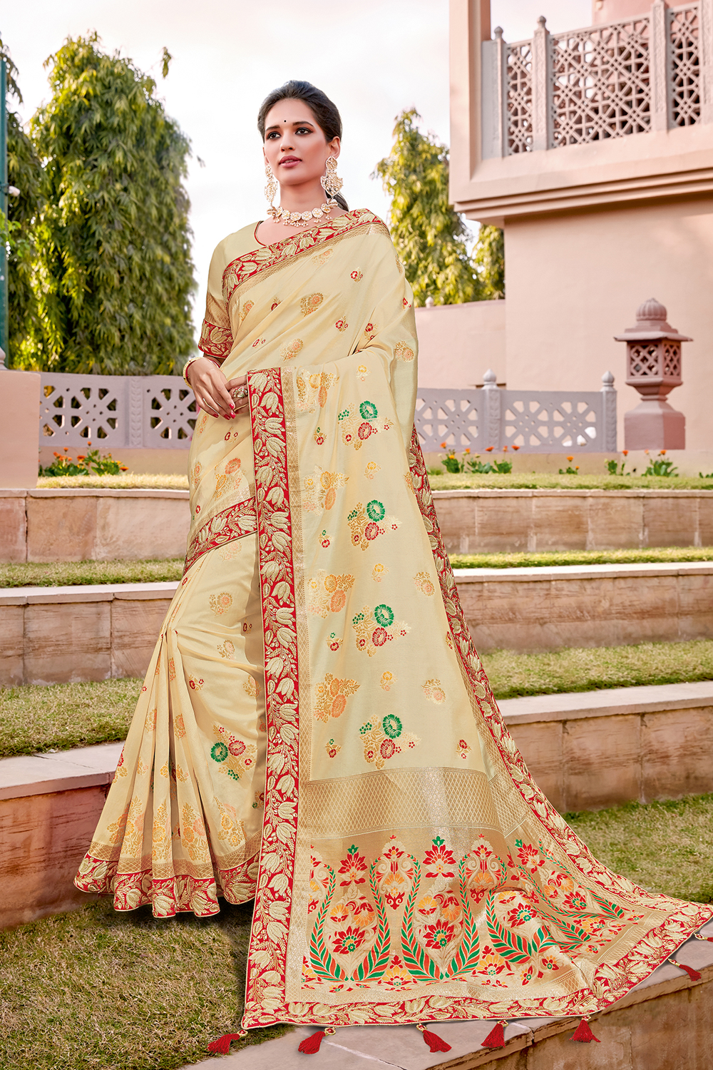Rich cream-and-red saree with subtle weave