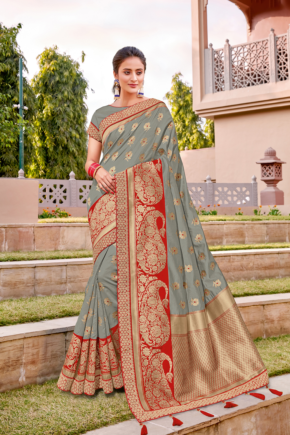 Muted grey saree enhanced with a right touch of red
