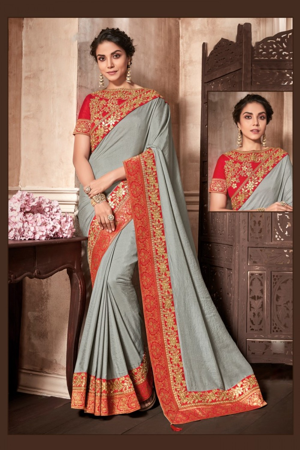 A classic  grey saree imbibed with red and gold detailings
