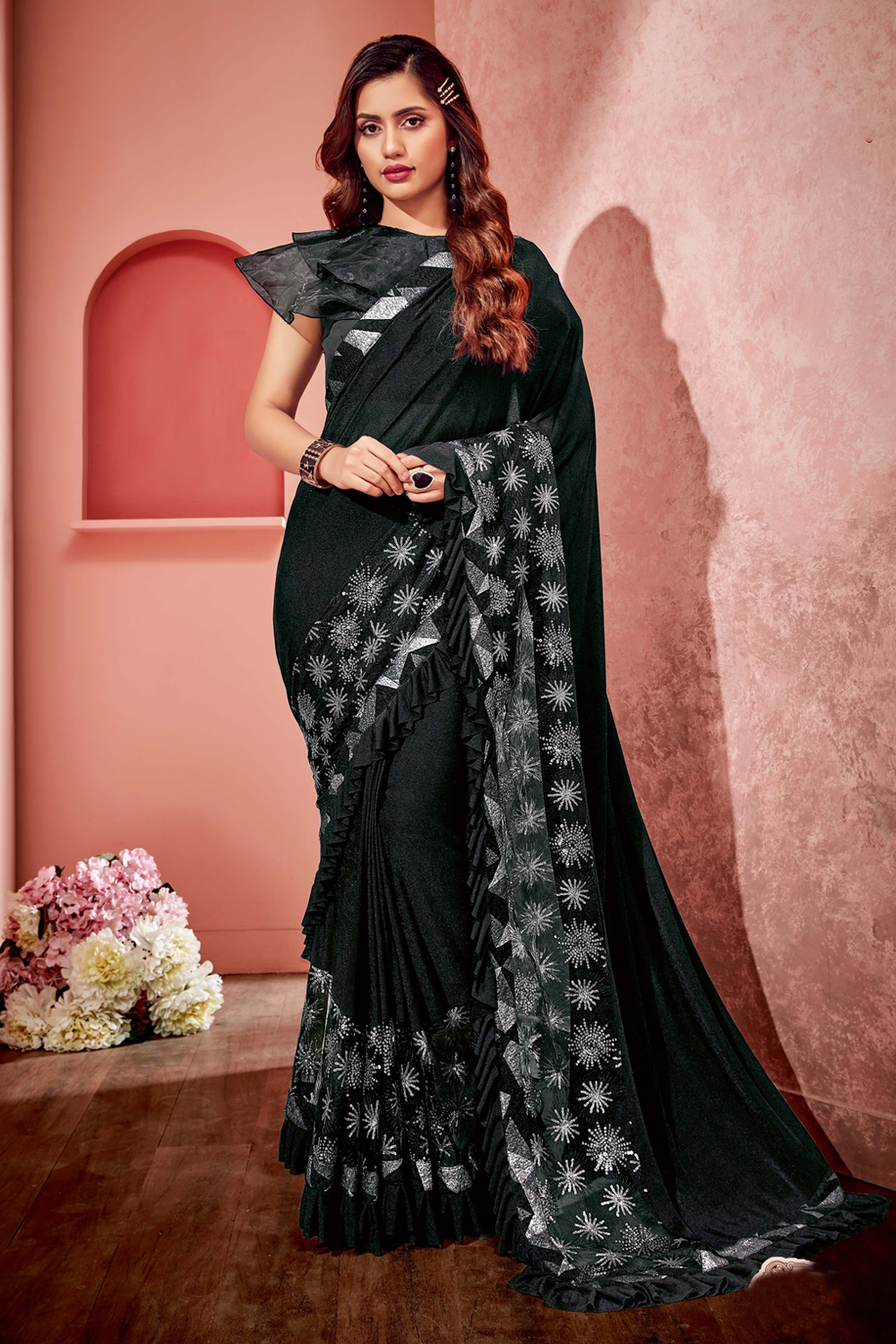 Black saree with its dramatic flair of frills