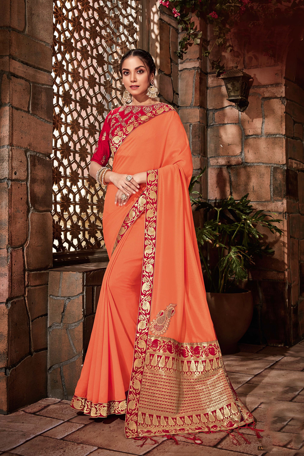 Saffron-red colors weaved beautifully with golden threads saree