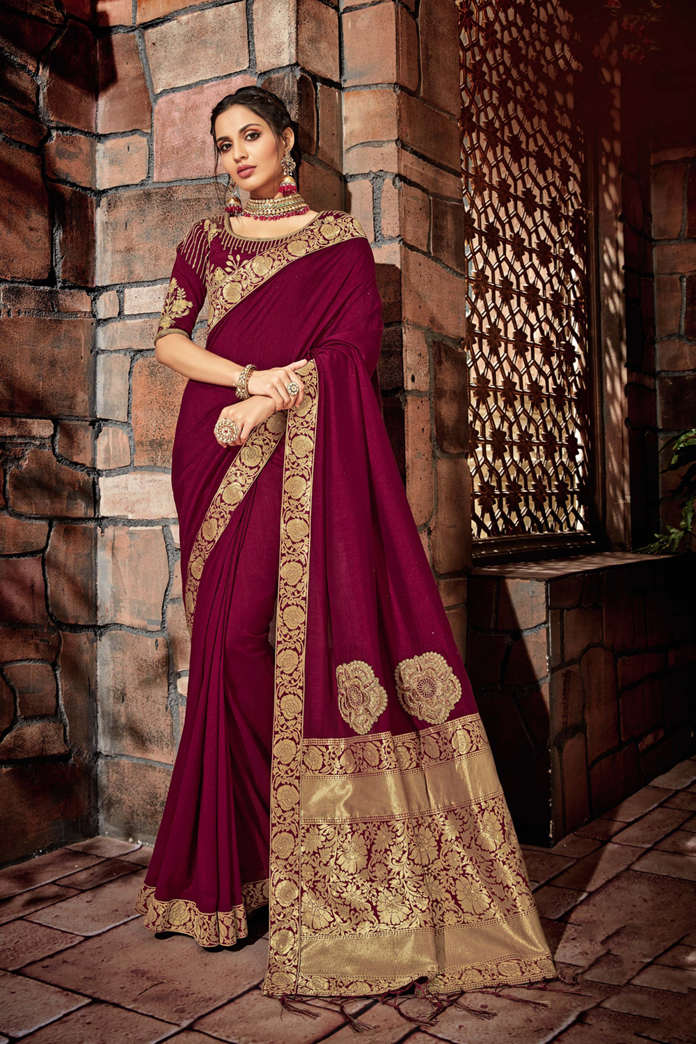 Magnificent wine and fabricated in golden motifs saree