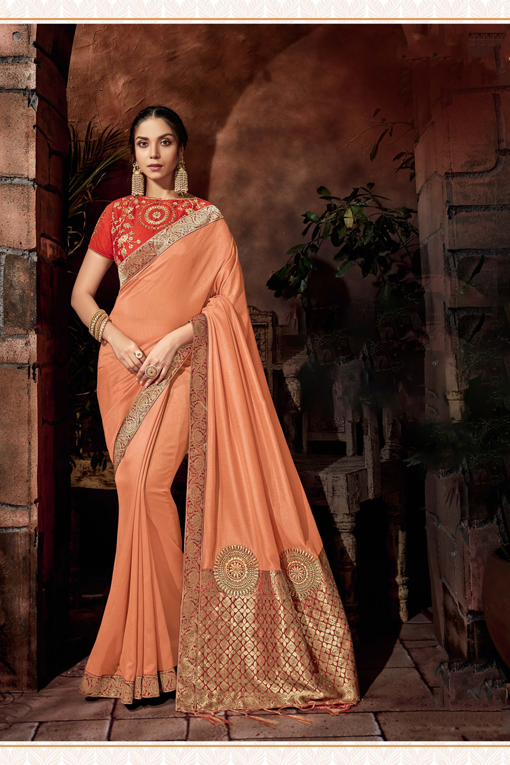 Intricate motifs and beautiful trims and details peach saree